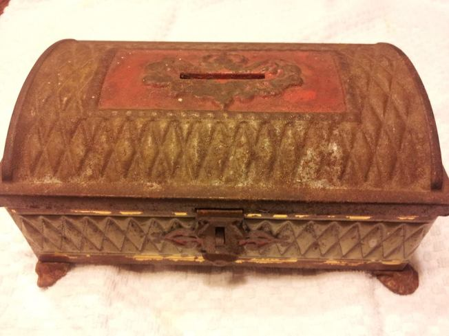 Antique Store Treasure that found a new home today. Lovingly used Metal Box Bank with red and green patina